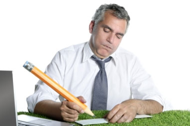 business man writing with pencil